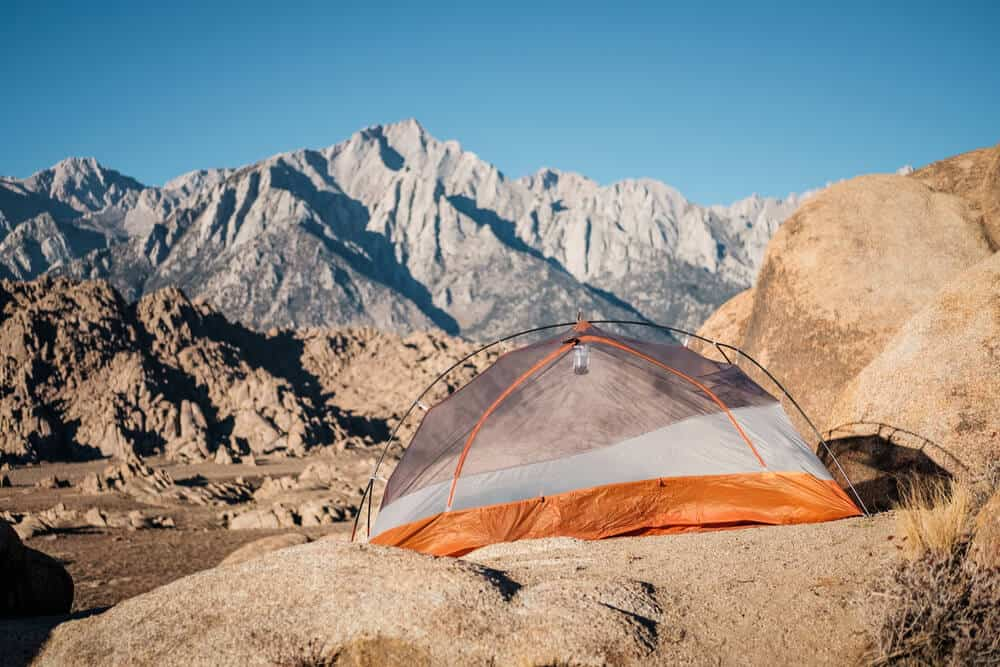 Camping in Alabama Hills, California with tent overlooking the Sierra Nevada mountains
