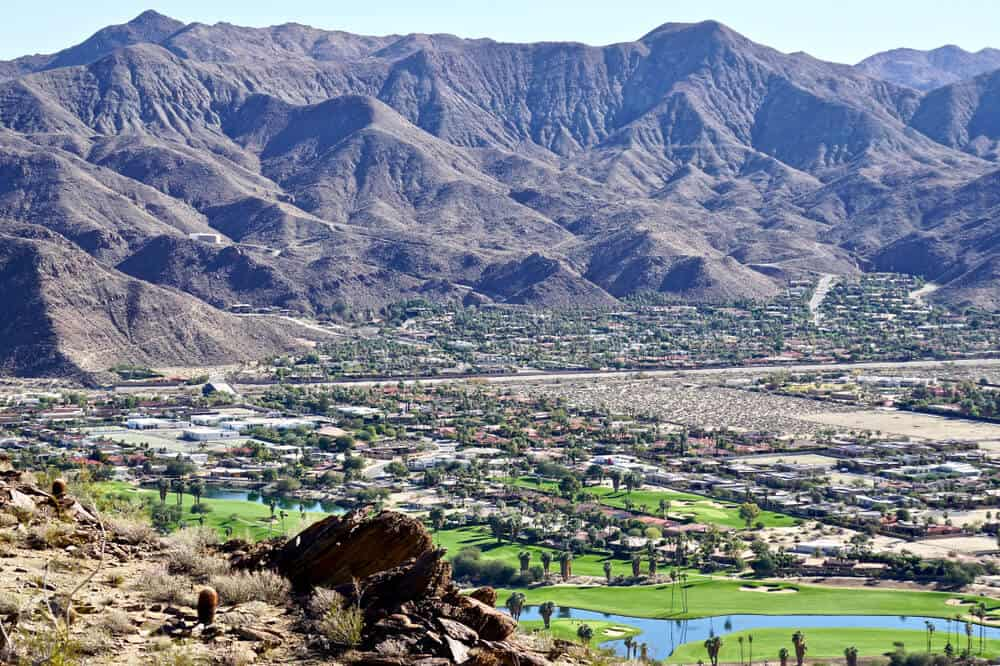 view of Indian Canyon Golf course in Palm Springs from hiking trails in Palm Springs