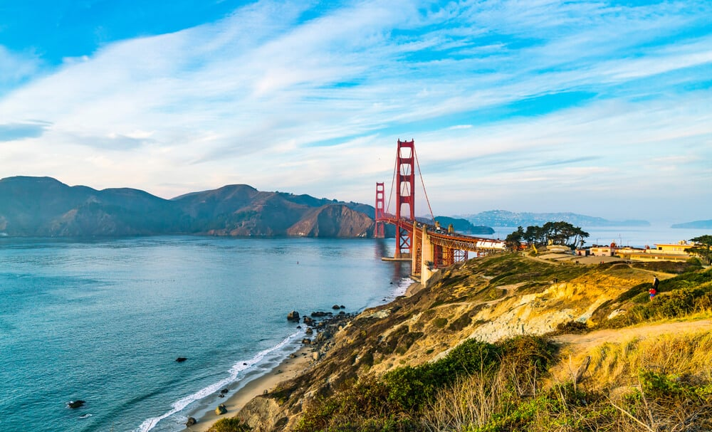 view of the golden gate bridge looking towards the marin headlands from above one of the beaches of san francisco