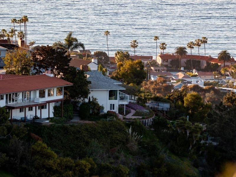 the beautiful oceanfront town of la jolla california with palm trees and houses