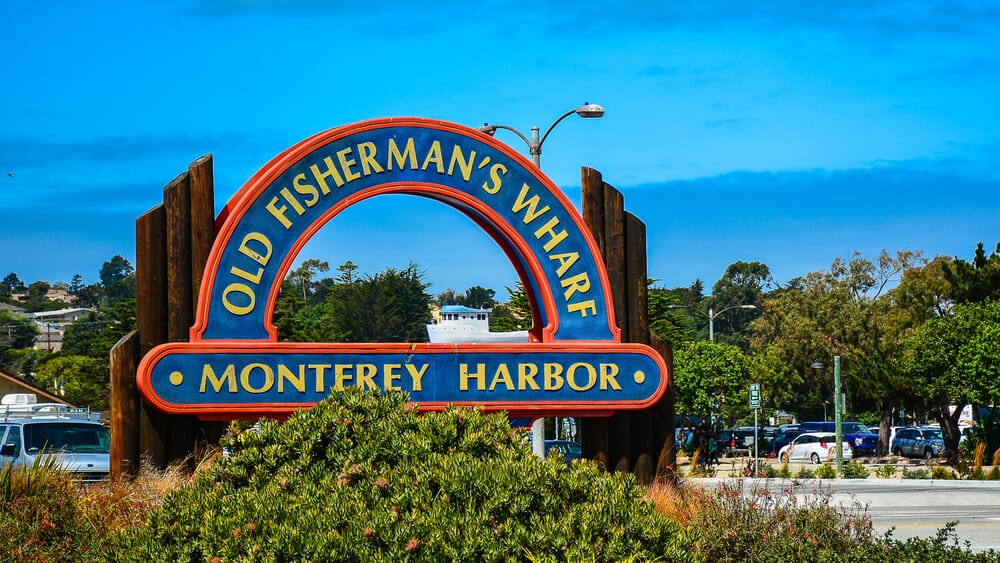 the sign for monterey california at the entrance to town on a sunny day