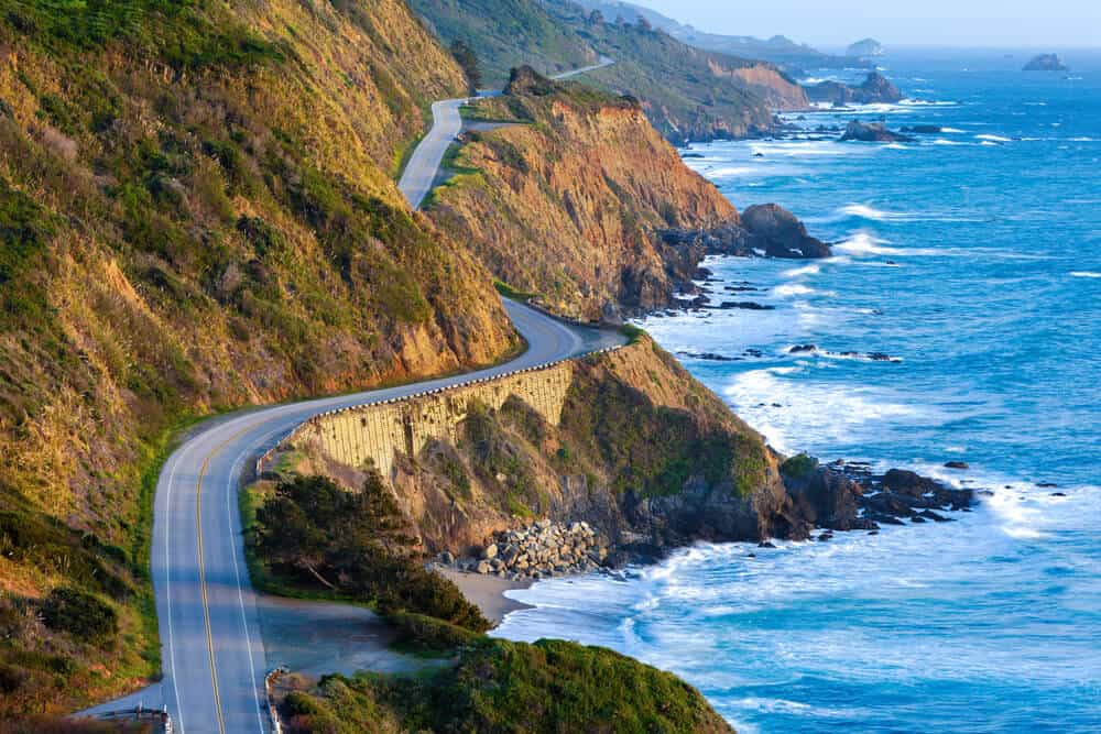 the twisting road of the pacific coast highway aka highway 1 along the pacific ocean with rocky shore