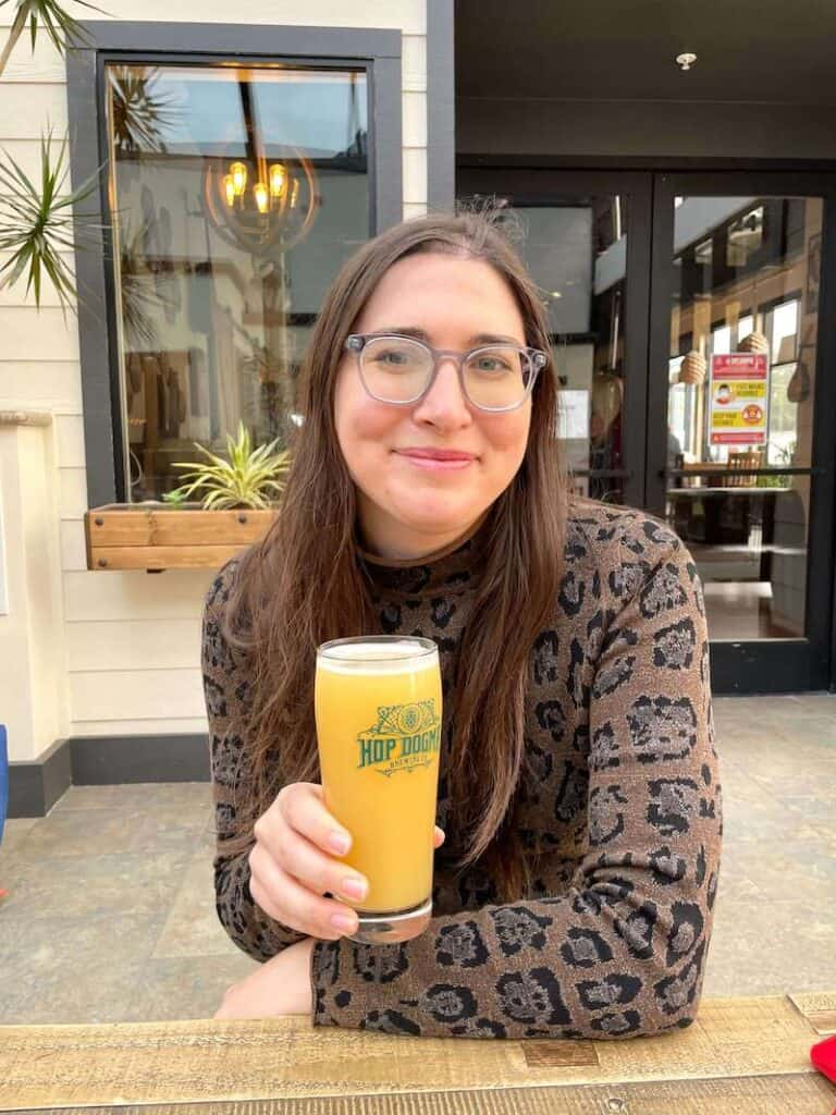 Allison (the author of the article) drinking a beer from hop dogma brewery in half moon bay