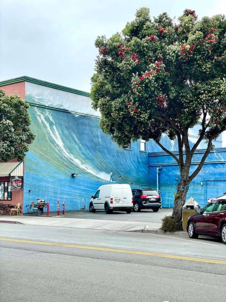 mural of a giant wave taking up two buildings