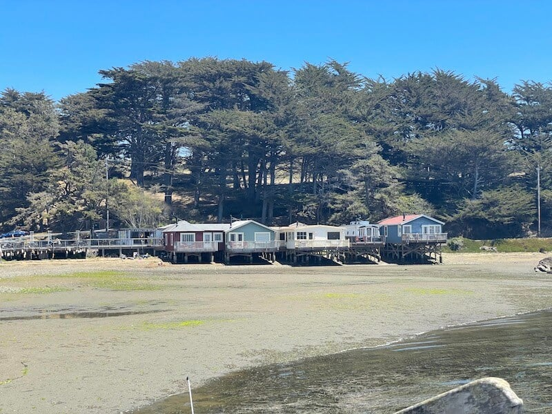 The waterfront cottages at Nick's at low tide