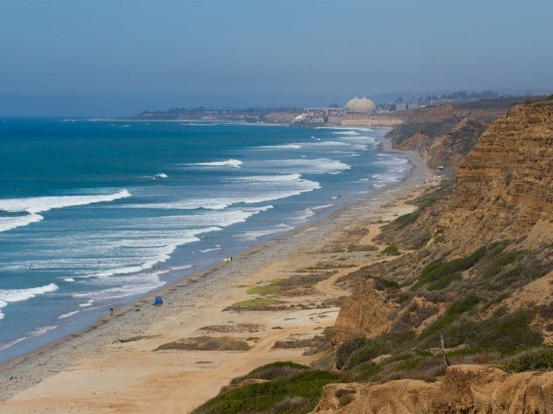 the coastline of san onofre state beach, one of the best places to go camping in orange county