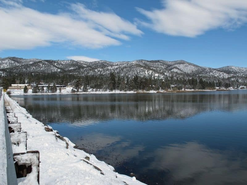 big bear lake in winter with snowfall and clear skies
