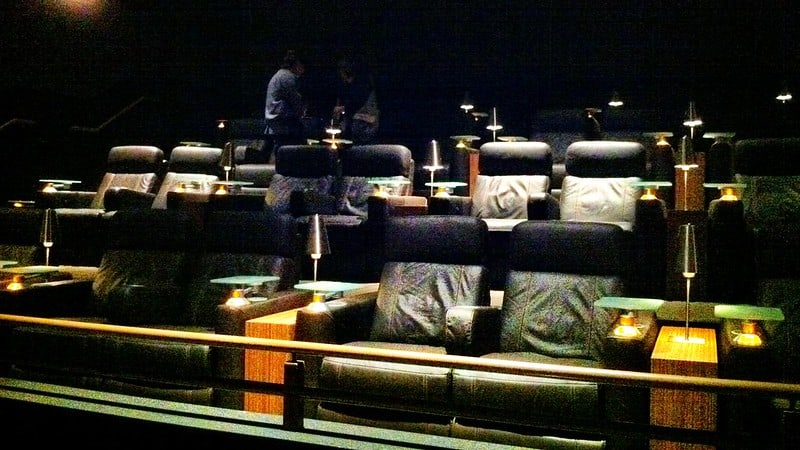 Cushy leather recliners in sets of two at a movie theater