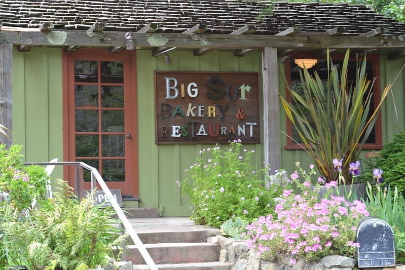 mix and match lettering on a green building that reads 'big sur bakery and restaurant'