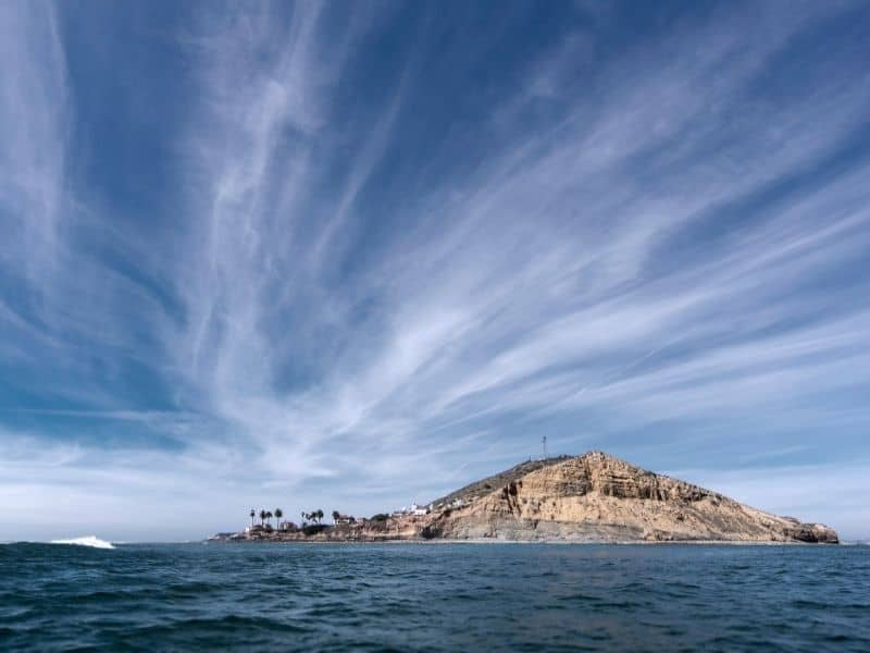 looking at the point loma lighthouse from afar out on the water