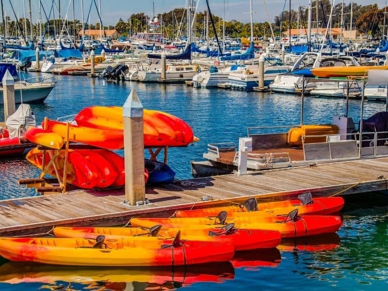 a row of kayaks in orange and red in mission bay california a great place for kayaking in southern california