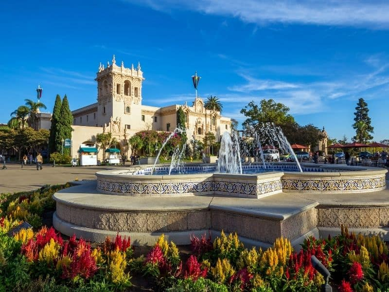 one of the main areas in balboa park with a water fountain and spanish colonial architeecture