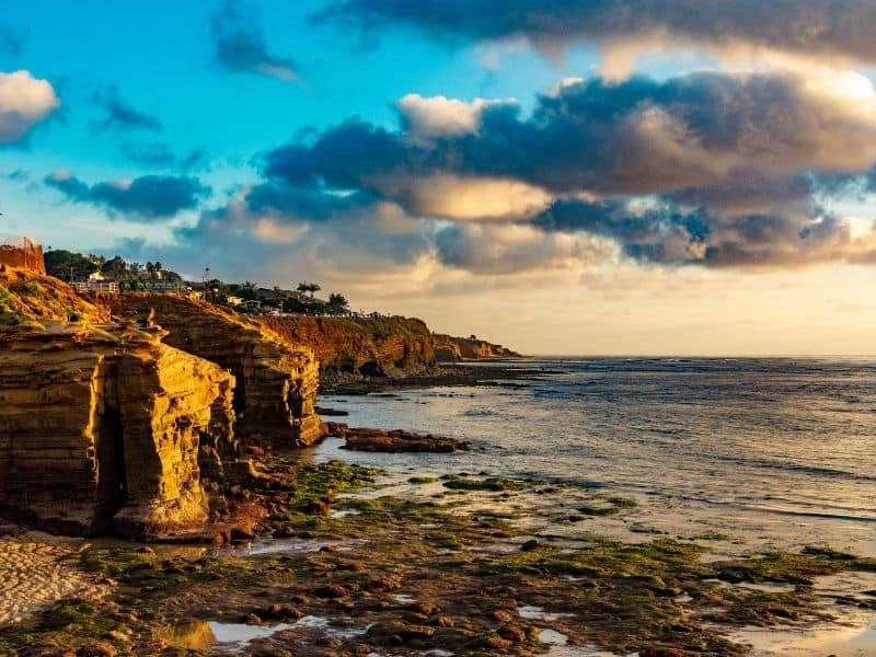 Dramatic orange and blue sunset light at Sunset Cliffs in San Diego, California