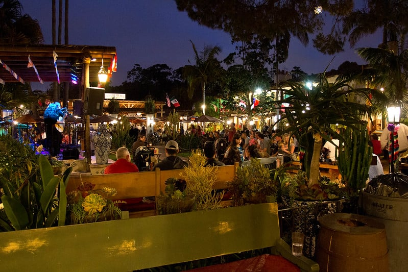 people gathering at tables sitting outside with groups of friends in old town san diego