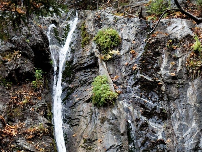 waterfall cascading over the rock edge of a cliff