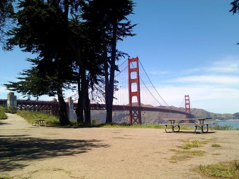 picnic table in front of the golden gate bridge with beautiful views of the water