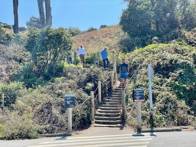 people walking up the stairs to begin the short battery east trail wich will take you up to the starting point for the golden gate bridge walk