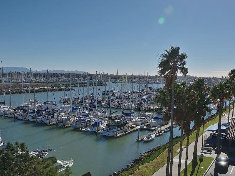The charming harbor of Ventura California with lots of boats along the waterfront