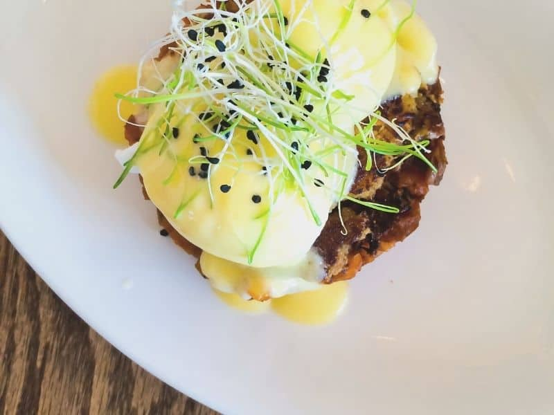 fancy crab cake benedict on a plate seen from above