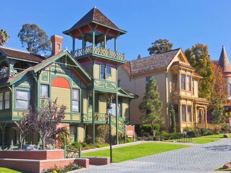 two buildings that are part of the old town san diego with old fashioned architectural style