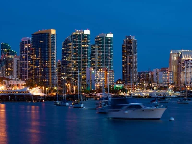city lights of san diego at night as seen from the harbor cruise