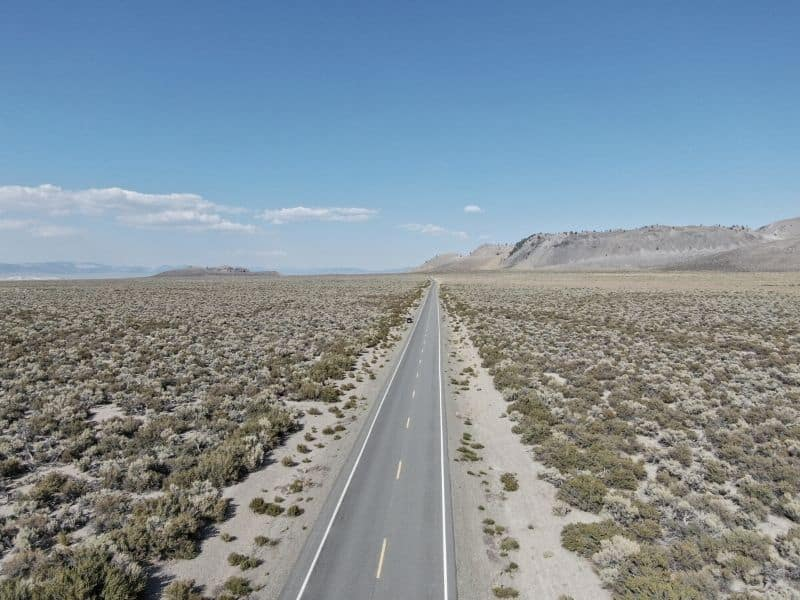 aerial view over a flat road in lee vining california