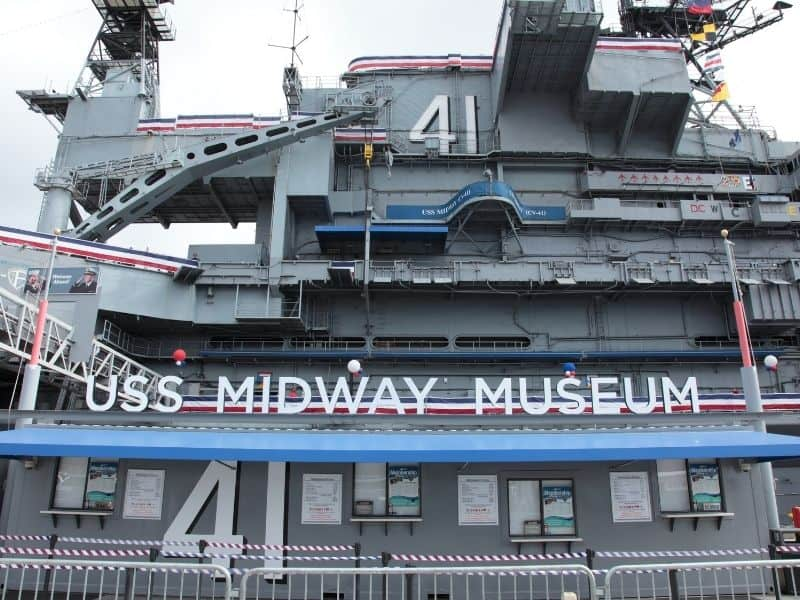 sign that reads uss midway museum located on a ship that is part of the museum complex