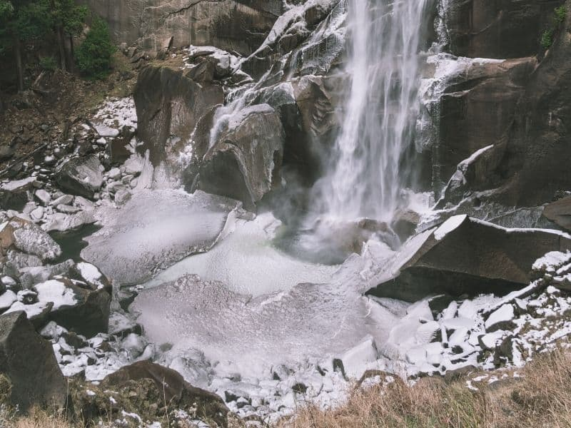 water pooling at vernal falls with ice and snow in the winter in yosemite