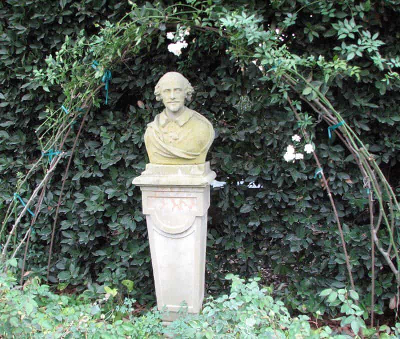 bust of william shakespeare surrounded by flora