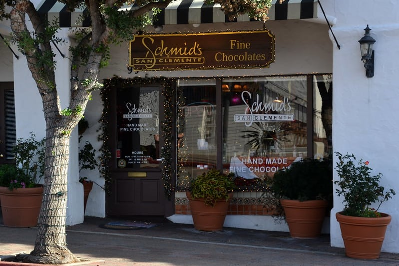 a sign for schmids fine chocolates in san clemente selling hand made fine chocolate
