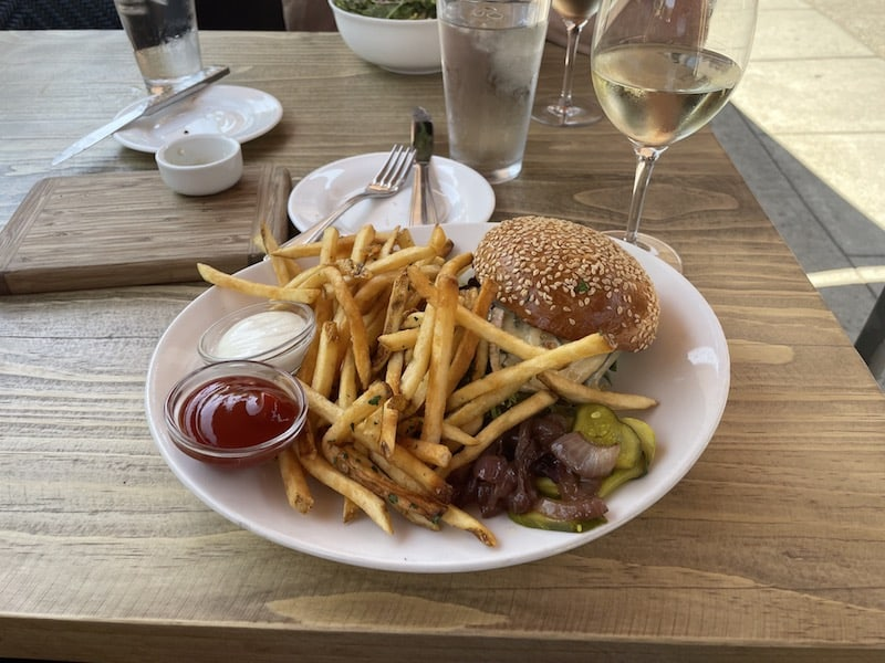 a perfect hamburger and fries and a glass of white wine at the girl and the fig on the sonoma square