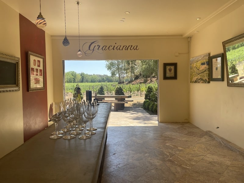 tasting room at gracianna winery with wine glasses cued up for people to come in