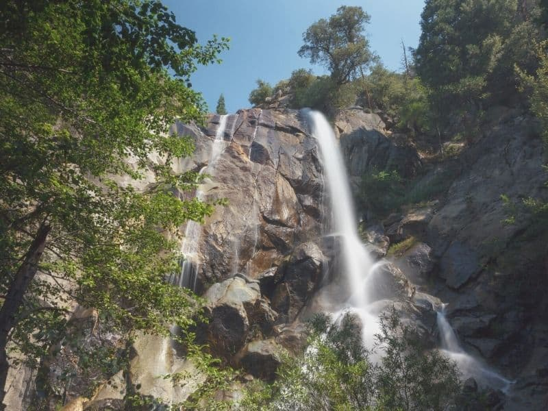 waterfall cascading over rocks from a cliff in kings canyon national park