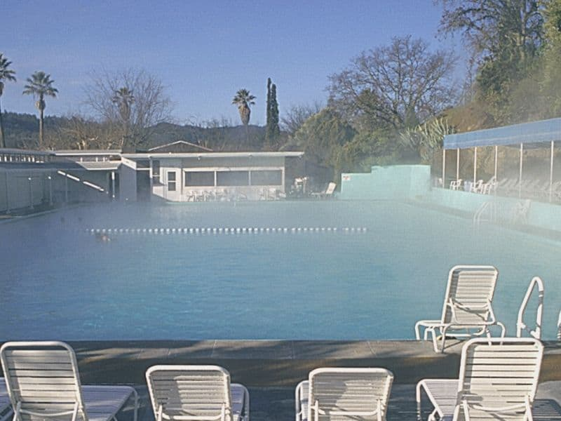 hot spring pool with pool chairs around it with no one in it in napa in winter